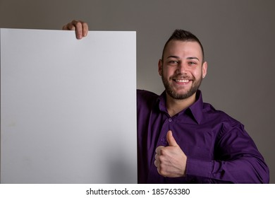 Young attractive man holding blank blackboard