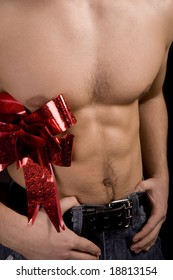 Young attractive man, leisure Clothing, Jeans and Red Bow