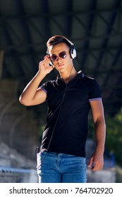 Young attractive man listening music with headphones