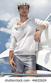 young attractive man looking away on a yacht, with a cloudy background .