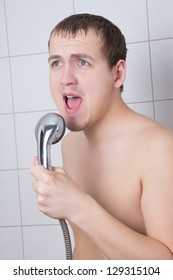 young attractive man singing in the shower