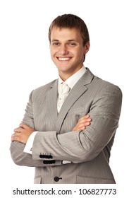Young attractive man smiling brightly and standing with arms crossed