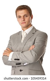 Young attractive man standing with arms crossed