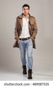 young attractive man in a trench rain coat