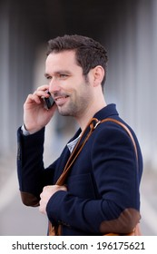Young attractive man using smartphone in Paris, France