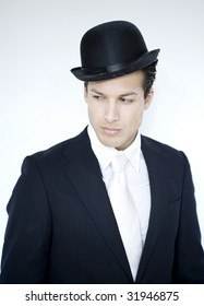 Young attractive man wears suit and black hat
