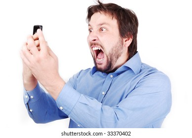 Young attractive man is yelling on his cell phone