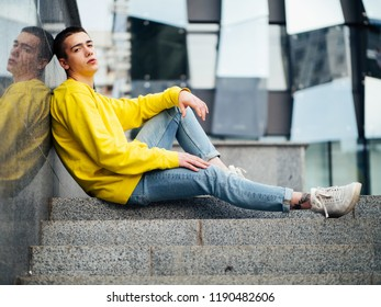 Young attractive man in a yellow sweater