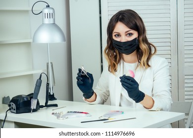 Young Attractive Manicurist Professional Master Of Manicure Woman In A White Jacketmask