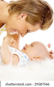 Young attractive mother kissing cute little baby