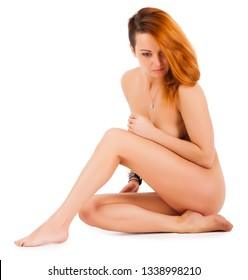 Young Attractive Naked Women Sitting on a White Background