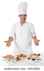 Young attractive nepalese man, chef showing diversity of oriental meals on plates. Studio shot, white background.