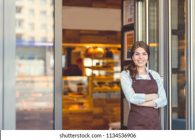 Young attractive owner in a bakery