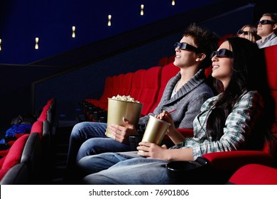 Young attractive people in the cinema
