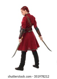 young and attractive red haired  female warrior,  wearing a red medieval tunic and leather Armour.  holding swords as weapons. back view.isolated on a white background.