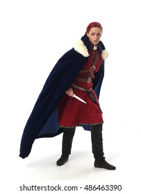 young and attractive red haired  female warrior,  wearing a red medieval tunic and leather Armour.  isolated on a white