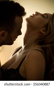 Young attractive sexy couple during foreplay