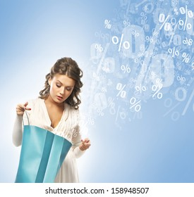 Young attractive shopper girl with the bags (discounts and sales concept)