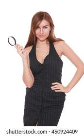 Young attractive smiling business woman using a magnifying glass, isolated on white background