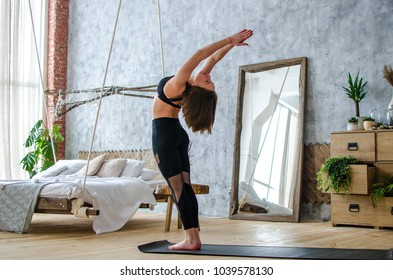 Young attractive smiling woman practicing yoga