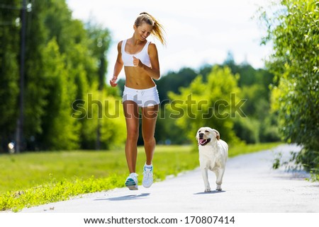 young attractive sport girl running dog の写真素材 今すぐ編集