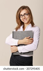 Young attractive successful business woman in glasses and working papers