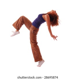 Young attractive teenage dancing over isolated white background