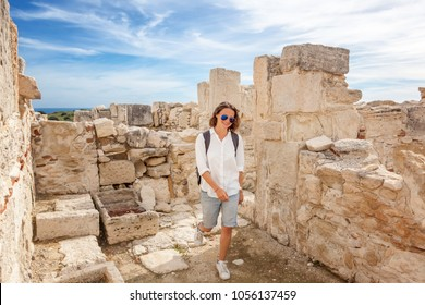 Young attractive tourist girl walks through the archaeological park during summer holidays, travel  to Cyprus, Courion ancient ruins, history