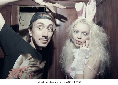 Young attractive trash man and woman making madness inside vintage lift