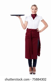 A young attractive waitress with a tray on a white background