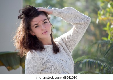 Young Attractive white woman posing with a tropical background