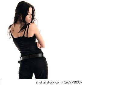 young attractive woman in black tank top and black jeans back shot profile face white background copy space