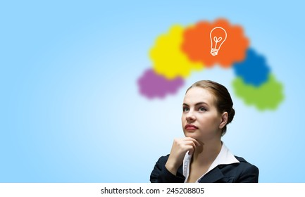 Young attractive woman and colorful thoughts above her head