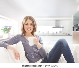 Young attractive woman with a cup of coffee