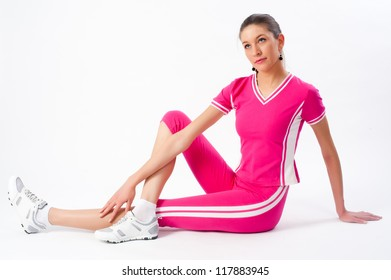 Young attractive woman doing exercise at white background
