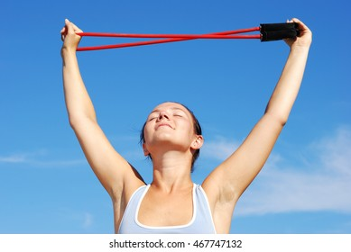 Young attractive woman doing morning sports exercises