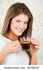 Young attractive  woman drinking coffee