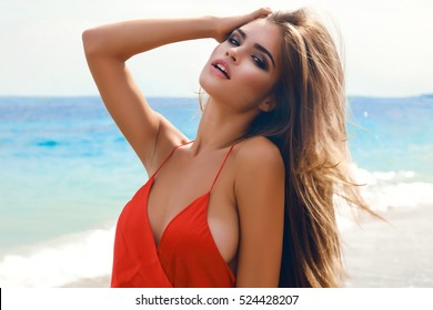 Young attractive woman face over summer white background,send kiss,with red lips,amazing woman,hairstyle after salon,beauty face,party make-up,summer accessories,perfect bronze tan skin,lovely face