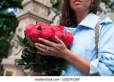 Young attractive woman with flowers. Bouquet of roses