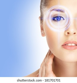 Young and attractive woman from future with the laser hologram on her eyes (collage about ophthalmology and eye scanning technology)