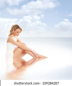 Young attractive woman getting spa treatment on the beach