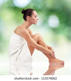 Young attractive woman getting spa on green background