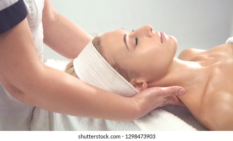 Young attractive woman getting spa treatment over white background.