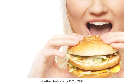 Young attractive woman with the hamburger