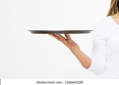 Young attractive woman holding empty tray isolated on white background. Copy space and mock up. Blank template background. Cropped image