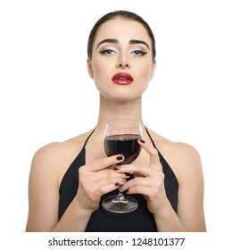 Young attractive woman holding glass of red wine. Pretty lady drinks alcoholic drink
