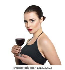 Young attractive woman holding glass of red wine. Pretty lady drinks alcoholic drink. Beautiful girl wearing black dress  with glass of wine isolated on white background.