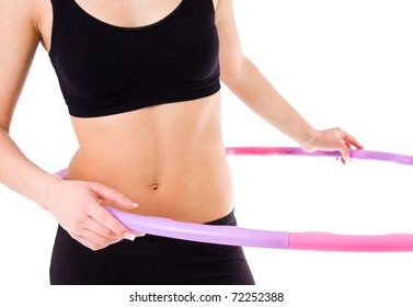 Young attractive woman holding hula hoop