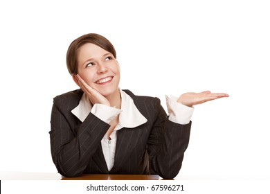 Young attractive woman holds palm and looks at corner at blank ad space . Isolated on white background.