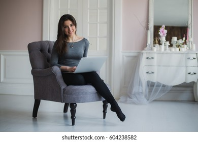 Young attractive woman at home, working with laptop, free online classes for interest, stay-at-home mom starting an online business, internet marketing, remote job, lady- blogger